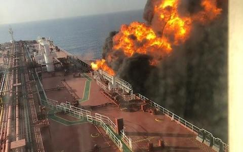 The fire rages on board one of the tankers - Credit: Fars News Agency