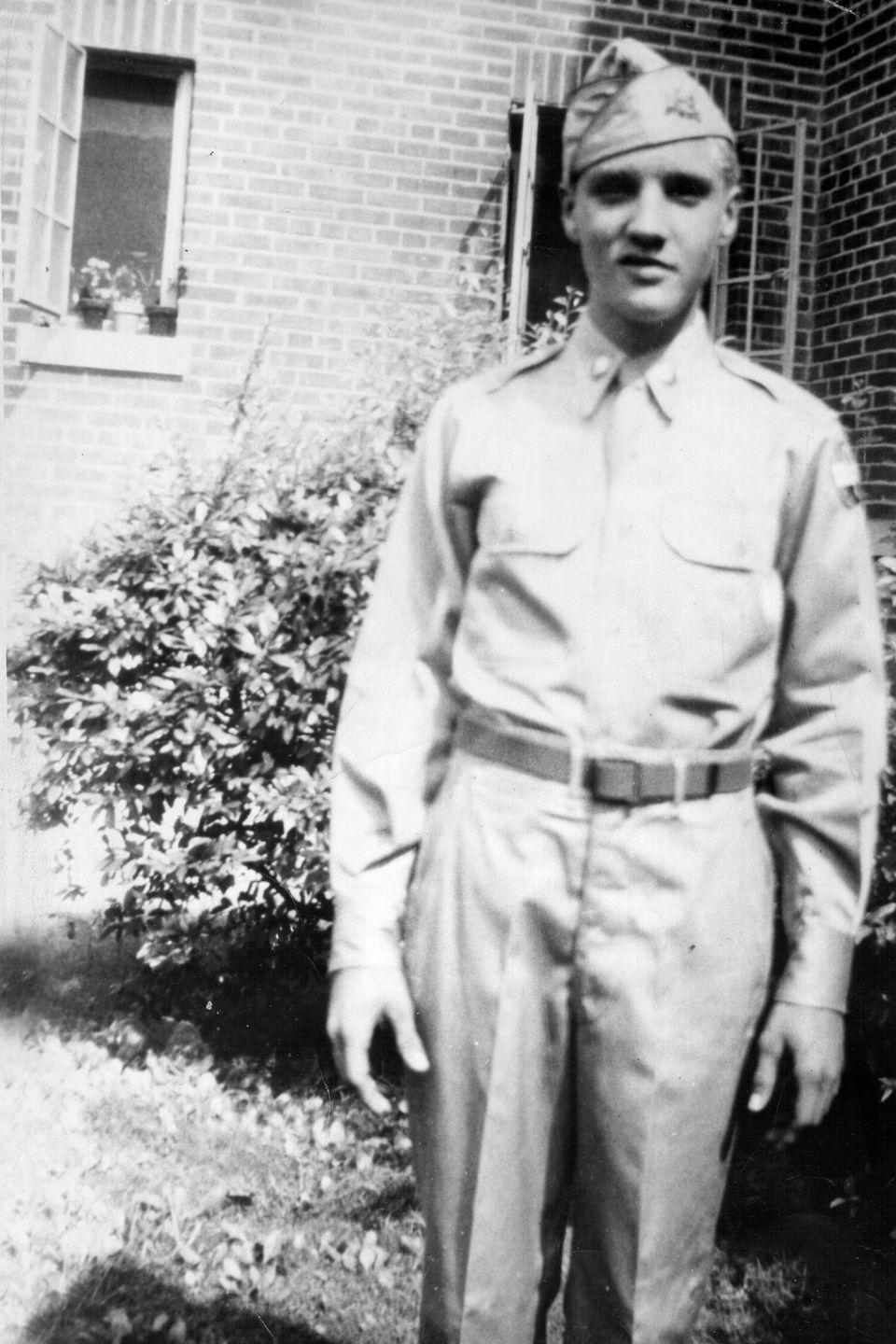 <p>In 1953, Presley graduated from Humes High School in Memphis, Tennessee. Here he is in his school's ROTC uniform. After graduating, he worked odd jobs to save enough money to record a demo.</p>