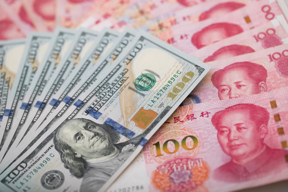 US and China currency notes. Photo: StudioEAST/Getty Images