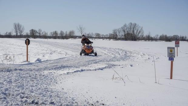 A snowmobiler approaches a stop sign in rural southeast Ottawa in February.