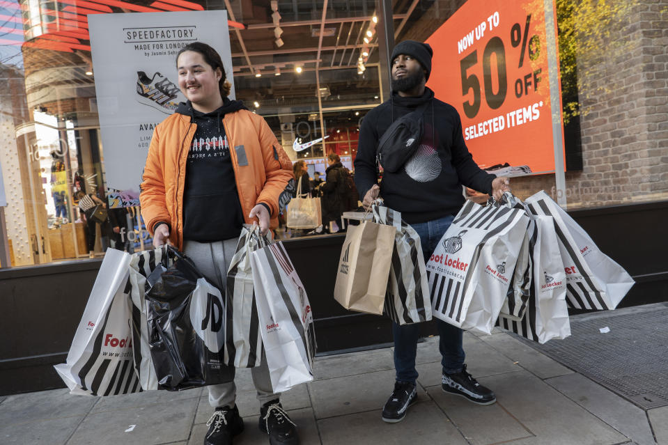 Shoppers outside a Foot Locker store on Londons Oxford Street for the Black Friday event on November 29, 2019, in London. (Photo by Sam Mellish / In Pictures via Getty Images)