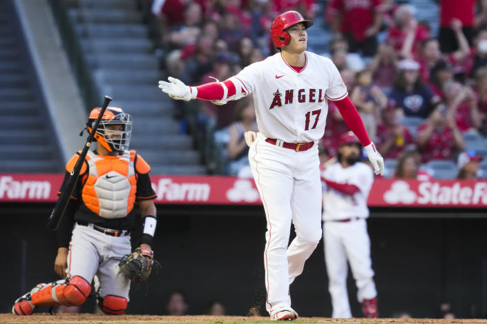 Los Angeles Angels designated hitter Shohei Ohtani (17) drops hit bat after hitting a home run during the third inning of a baseball game against the Baltimore Orioles Friday, July 2, 2021, in Anaheim. (AP Photo/Ashley Landis)