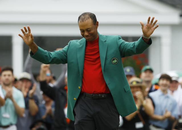FILE - In this April 14, 2019, file photo, Tiger Woods smiles as he wears his green jacket after winning the Masters golf tournament in Augusta, Ga. Fourteen years after his last Masters win and 11 years after his last major, after fighting through chronic back problems, multiple surgeries, a bout with painkillers and long after just about everybody had written him off, Woods claimed his fifth green jacket. (AP Photo/Matt Slocum, File)