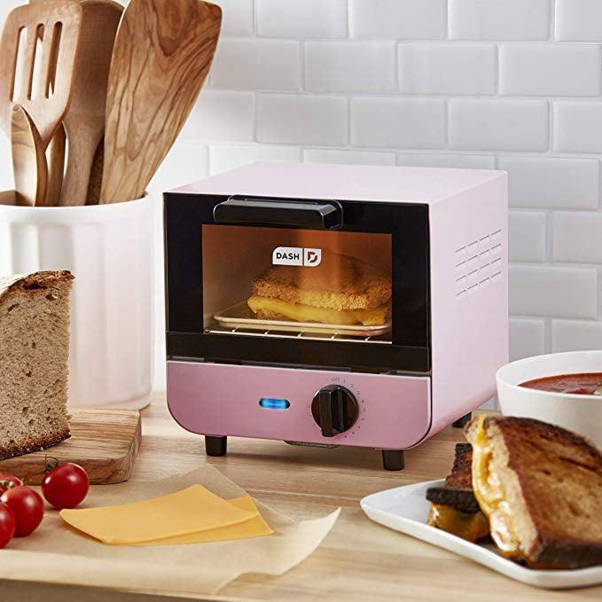 <p>You can also get this <span>Dash Mini Toaster Oven</span> ($35) in red.</p>