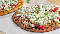 """<p>Making pizza at home is one of <a href=""""https://www.thedailymeal.com/cook/easy-recipes-kid-dinner-dessert-crafts?referrer=yahoo&category=beauty_food&include_utm=1&utm_medium=referral&utm_source=yahoo&utm_campaign=feed"""" rel=""""nofollow noopener"""" target=""""_blank"""" data-ylk=""""slk:the best ways to get your kids involved in the kitchen"""" class=""""link rapid-noclick-resp"""">the best ways to get your kids involved in the kitchen</a>. If you want a super quick weeknight meal, toss some naan on the grill and use it as the base for deeply flavored flatbreads. The charred flavor complements creamy goat cheese and tomatoes (the latter of which you can also quickly throw on the grill for extra juiciness).</p> <p><a href=""""https://www.thedailymeal.com/best-recipes/spiced-indian-flatbread-naan?referrer=yahoo&category=beauty_food&include_utm=1&utm_medium=referral&utm_source=yahoo&utm_campaign=feed"""" rel=""""nofollow noopener"""" target=""""_blank"""" data-ylk=""""slk:For the Grilled Indian-Spiced Flatbread recipe, click here."""" class=""""link rapid-noclick-resp"""">For the Grilled Indian-Spiced Flatbread recipe, click here.</a></p>"""