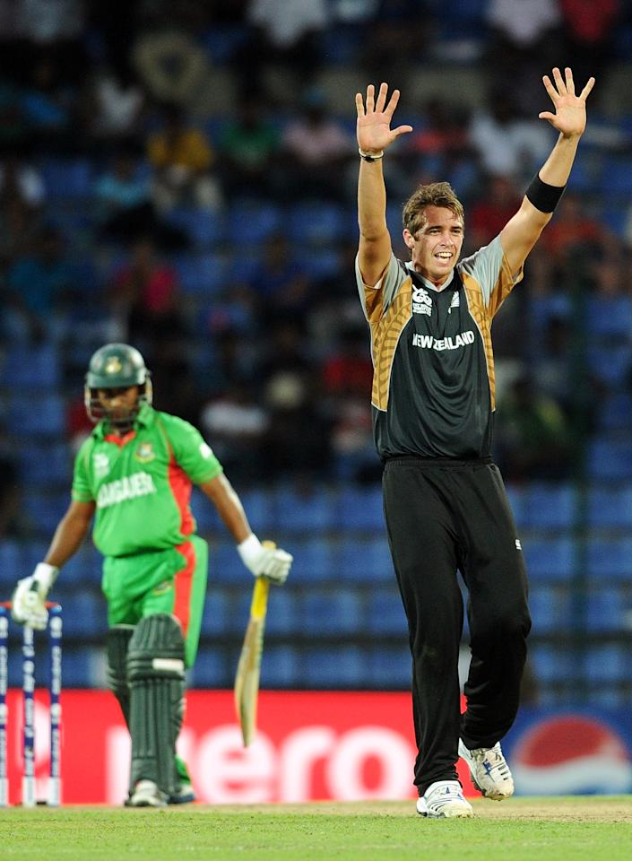 New Zealand cricketer Tim Southee (R) appeals successfully for a LBW for Bangladesh batsman Mohammad Ashraful during the ICC Twenty20 Cricket World Cup match between Bangladesh and New Zealand at The Pallekele International Cricket Stadium in Pallekele  on September 21, 2012. AFP PHOTO/ Prakash SINGH