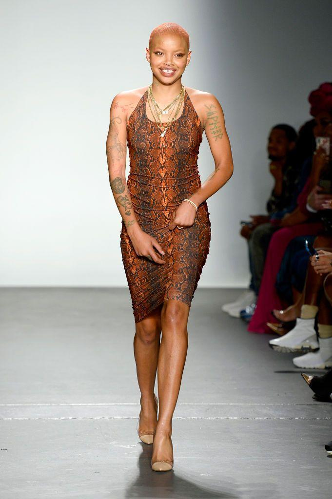 "<p>Slick Woods has walked down countless runways ranging from Marc Jacobs to Savage x Fenty (she was pregnant in the latter brand's 2018 show and <a href=""https://www.cosmopolitan.com/entertainment/a23119944/slick-woods-labor-birth-savage-fenty-fashion-show/"" rel=""nofollow noopener"" target=""_blank"" data-ylk=""slk:went into labor right after"" class=""link rapid-noclick-resp"">went into labor right after</a>!). You might also recognize her signature gap-tooth smile, seen here on the LaQuan Smith runway. </p>"