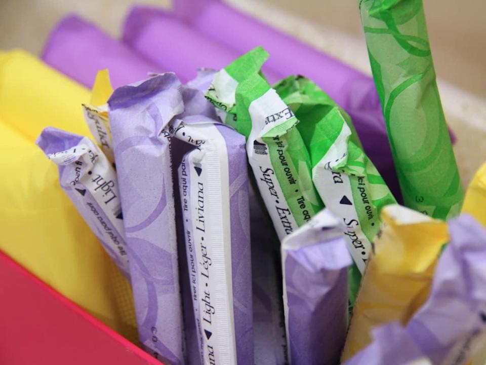 The City of Calgary, in partnership with the Calgary Public Library and Mayor's Youth Council, is making period products available for free in some public buildings.  (Kate Bueckert/CBC - image credit)