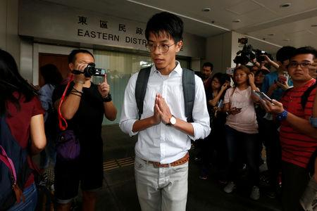 A leader of localist group Hong Kong Indigenous leaves a court in Hong Kong
