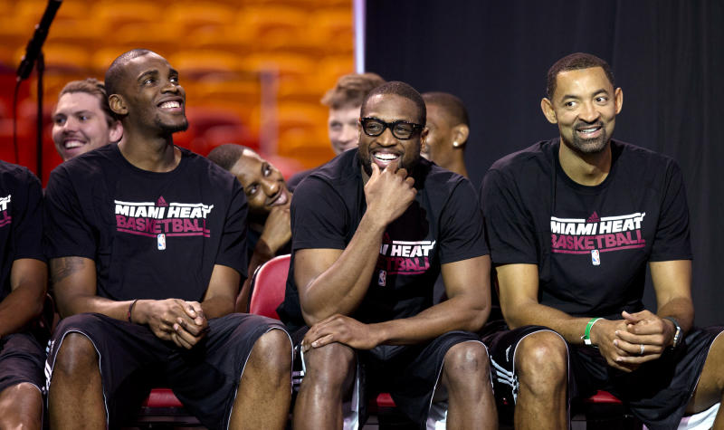 From left, Miami Heat's Jarvis Varnado, Dwyane Wade and Juwan Howard watch a video after LeBron James was awarded his fourth Most Valuable Player trophy during an NBA basketball news conference, Sunday, May 5, 2013, in Miami. (AP Photo/J Pat Carter)