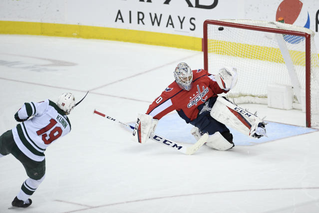 Minnesota Wild center Luke Kunin (19) scores a goal against Washington Capitals goaltender Braden Holtby (70) during the third period of an NHL hockey game Friday, March 22, 2019, in Washington. The Wild won 2-1. (AP Photo/Nick Wass)