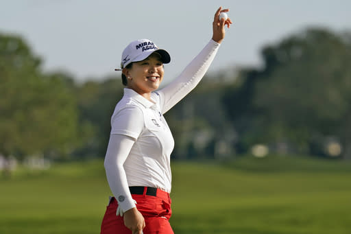 Sei Young Kim, of South Korea, celebrates after winning the LPGA Pelican Women's Championship golf tournament Sunday, Nov. 22, 2020, in Belleair, Fla. (AP Photo/Chris O'Meara)