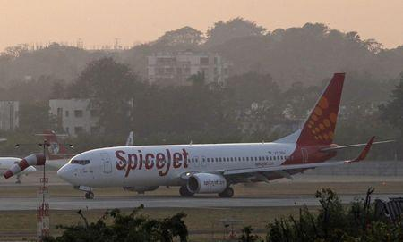 A SpiceJet aircraft taxis on the tarmac after landing at Chhatrapati Shivaji international airport in Mumbai