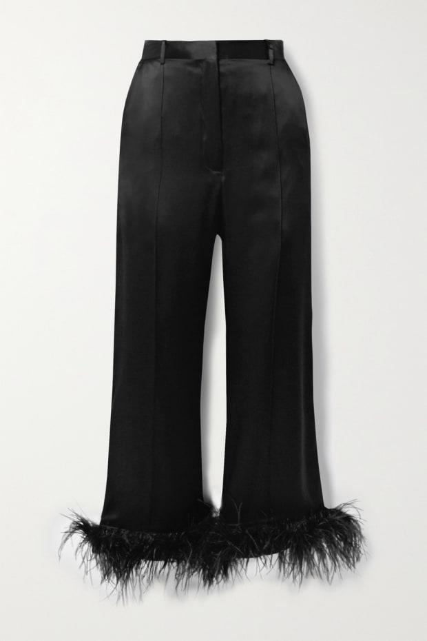 "<p>Michael Lo Sordo Cropped Feather-Trimmed Silk-Satin Wide-Leg Pants, $345, <a href=""https://rstyle.me/+sE6lDIswkMBOTr2rX12MHA"" rel=""nofollow noopener"" target=""_blank"" data-ylk=""slk:available here"" class=""link rapid-noclick-resp"">available here</a>.</p>"