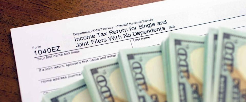 U.S. Individual income tax return 1040. accounter work with taxes. Lodging your tax return. Prepare for Tax Time.