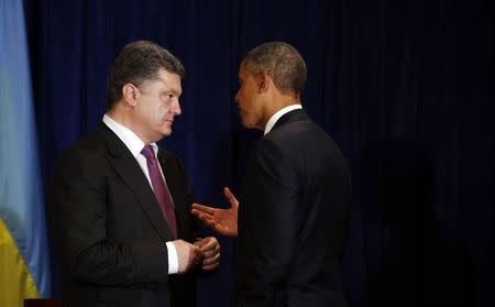 U.S. President Barack Obama meets with Ukraine's President-elect Petro Poroshenko in Warsaw June 4, 2014. Obama promised on Tuesday to beef up military support for eastern European members of the NATO alliance who fear they could be next in the firing line after the Kremlin's intervention in Ukraine.  REUTERS/Kevin Lamarque