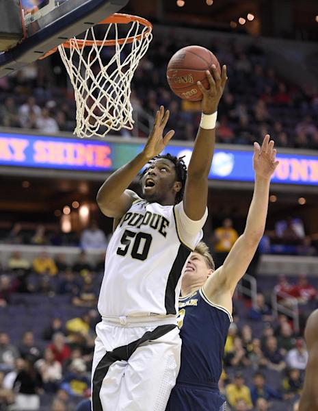 Purdue forward Caleb Swanigan (50) goes to the basket ahead of Michigan forward Moritz Wagner, right, during the first half of an NCAA college basketball game in the Big Ten tournament, Friday, March 10, 2017, in Washington. (AP Photo/Nick Wass)
