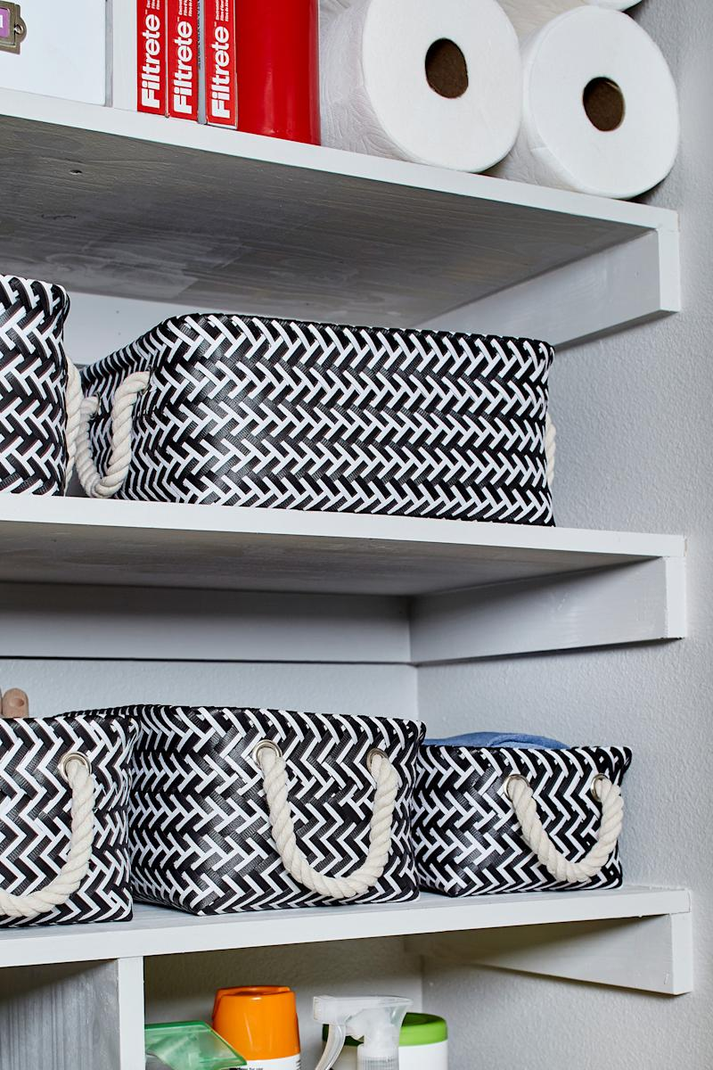 White shelving with black white baskets