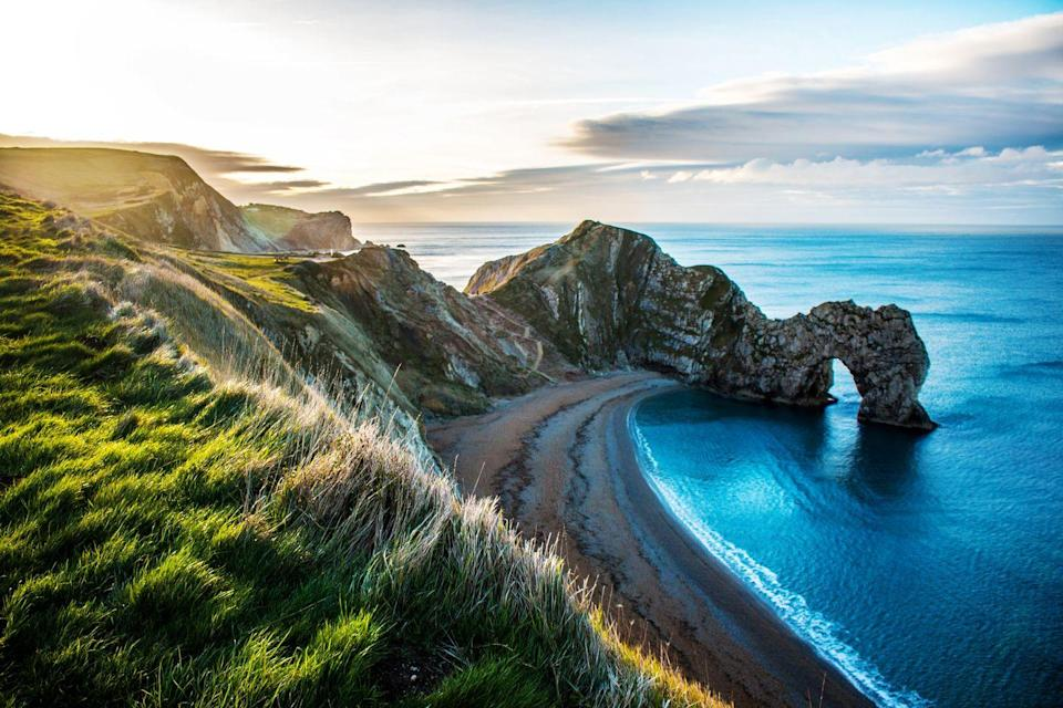 """<p><strong>Looks like:</strong> Penida Island, Bali</p><p>Get your fix of paradise-like shorelines, jaw-dropping cliffs and rock formations at Durdle Door, a natural limestone arch on the Jurassic Coast near Lulworth in Dorset. It might not be anywhere near as isolated as Penida Island, but you can't blame the crowds for wanting to gawp at this beautiful coastal spot.</p><p><strong>Stay at:</strong> It doesn't get much better than <a href=""""https://www.thepighotel.com/on-the-beach/"""" rel=""""nofollow noopener"""" target=""""_blank"""" data-ylk=""""slk:The Pig on the Beach"""" class=""""link rapid-noclick-resp"""">The Pig on the Beach</a>, a 16th-century house transformed into a tastefully rustic idyll that overlooks Dorset's rugged beaches.</p>"""