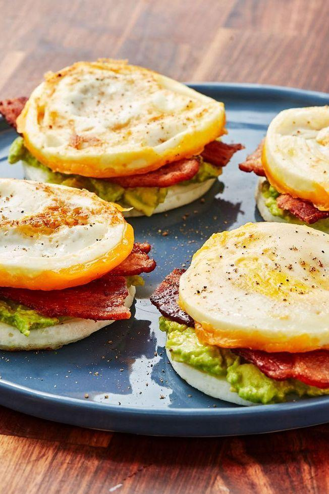 """<p>Using the egg for the bun on this classic <a href=""""https://www.delish.com/uk/cooking/recipes/g30312476/low-carb-breakfast-recipes/"""" rel=""""nofollow noopener"""" target=""""_blank"""" data-ylk=""""slk:breakfast"""" class=""""link rapid-noclick-resp"""">breakfast</a> sandwich is a true genius move. We loaded ours up with bacon, cheddar, and avocado but go for some of your favourite fillings! Sausage and gruyère would be killer too!</p><p>Get the <a href=""""https://www.delish.com/uk/cooking/recipes/a30805681/bunless-bacon-egg-and-cheese-recipe/"""" rel=""""nofollow noopener"""" target=""""_blank"""" data-ylk=""""slk:Bunless Bacon, Egg & Cheese"""" class=""""link rapid-noclick-resp"""">Bunless Bacon, Egg & Cheese</a> recipe.</p>"""