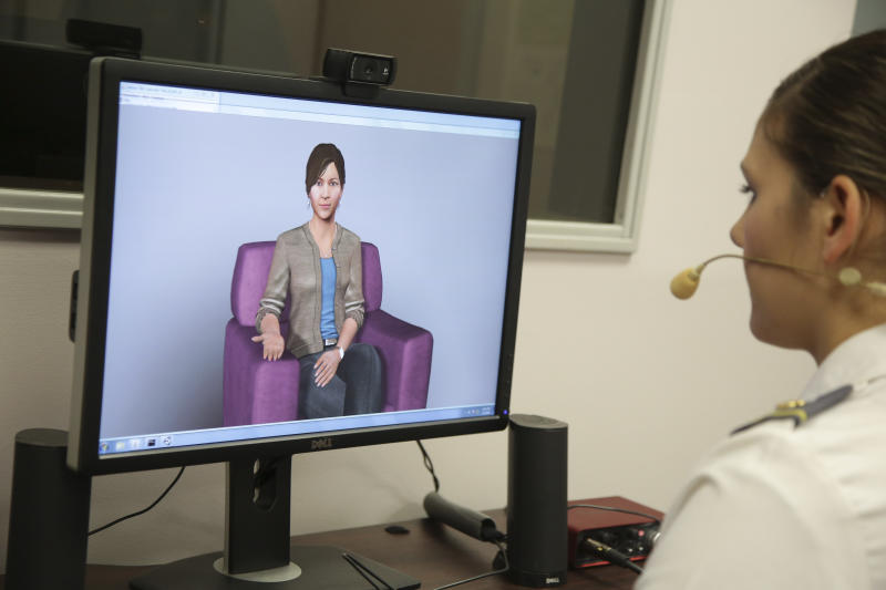 """In this file photo from May 2, 2019, Cadet Cheyenne Quilter works with a virtual reality character named """"Ellie"""" at the U.S. Military Academy at West Point, N.Y. Artificial intelligence is spreading into health care, often as software or a computer program capable of learning from large amounts of data and making predictions to guide care or help patients. (AP Photo/Seth Wenig, File)"""