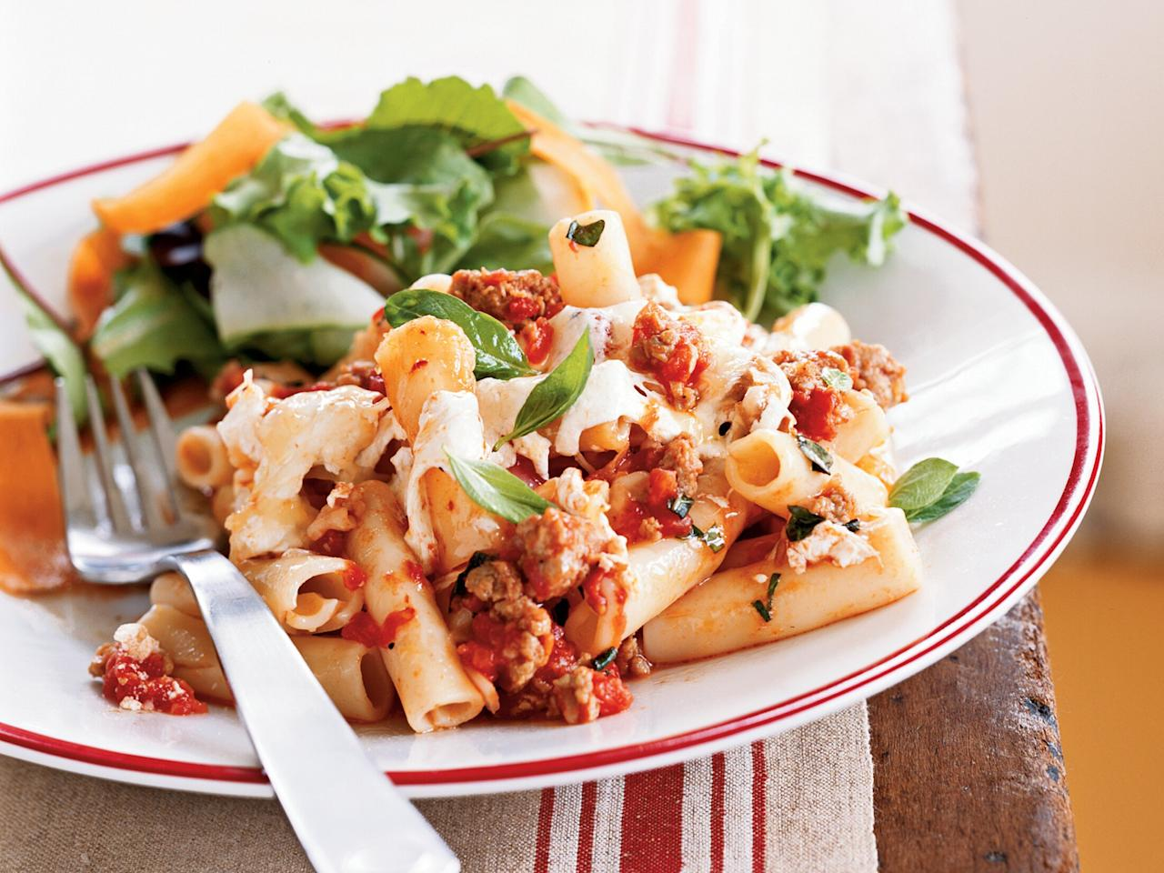 "<p>This easy, cheesy pasta recipe features ziti, turkey sausage, canned tomatoes, and fresh basil. It's a perfect pasta dish for busy weeknights.</p> <p><a href=""https://www.myrecipes.com/recipe/baked-pasta-with-sausage-tomatoes-cheese"">Baked Pasta with Sausage, Tomatoes, and Cheese Recipe</a></p>"