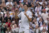 Poland's Hubert Hurkacz celebrates after defeating Switzerland's Roger Federer during the men's singles quarterfinals match on day nine of the Wimbledon Tennis Championships in London, Wednesday, July 7, 2021. (AP Photo/Kirsty Wigglesworth)