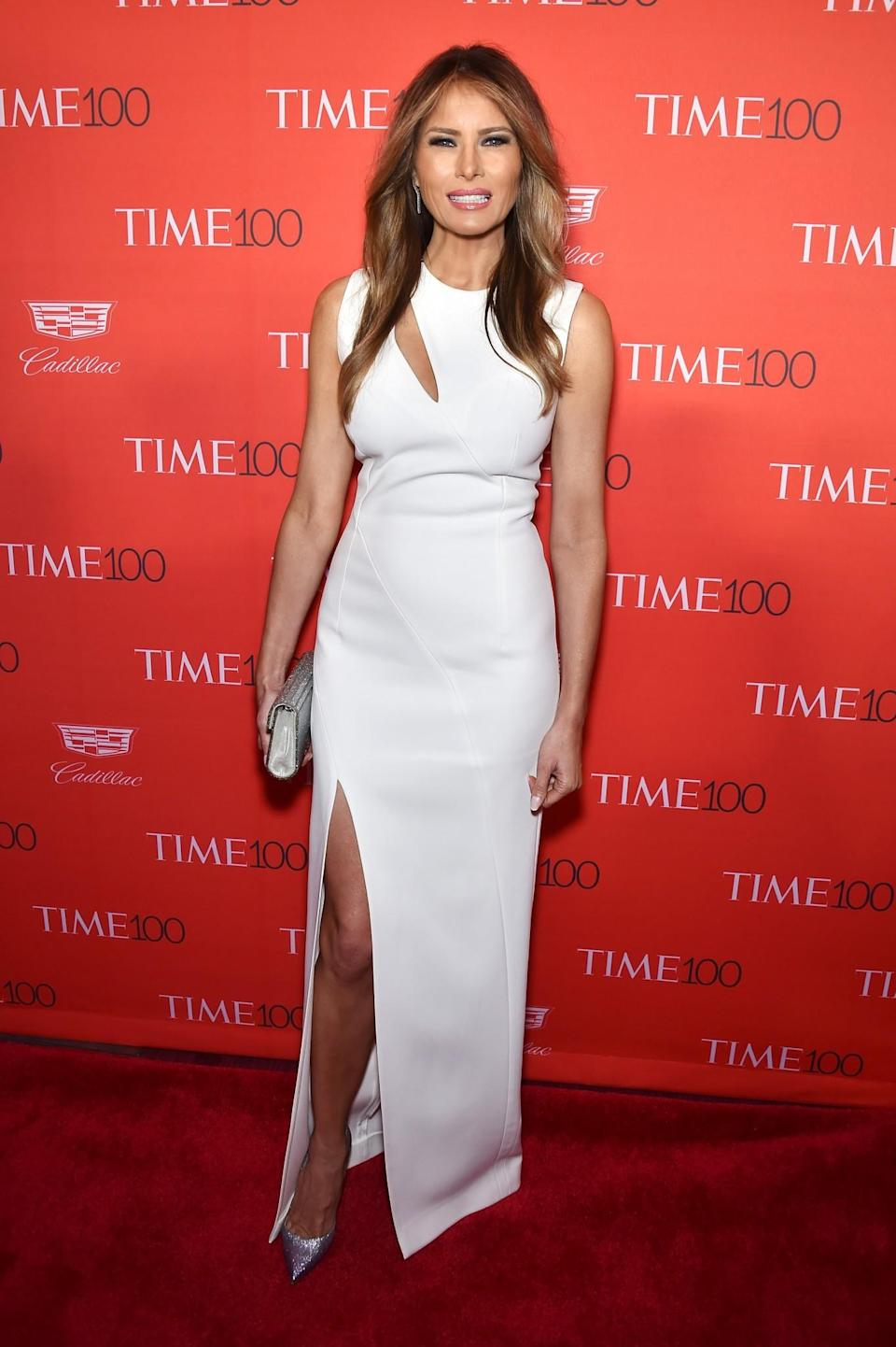 <p>Melania showed how it's done at the Time 100 Gala in a showstopping white gown with a thigh-high slit and cut-out detailing. Sparkly silver stilettos finished the look. <i>[Photo: Getty]</i> </p>