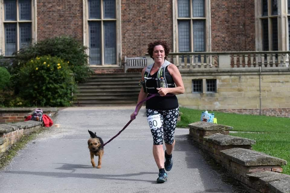Helen Foster, pictured running with dog Spud, is four stone lighter and 100% fitter and happier since she took up running. (Helen Foster)