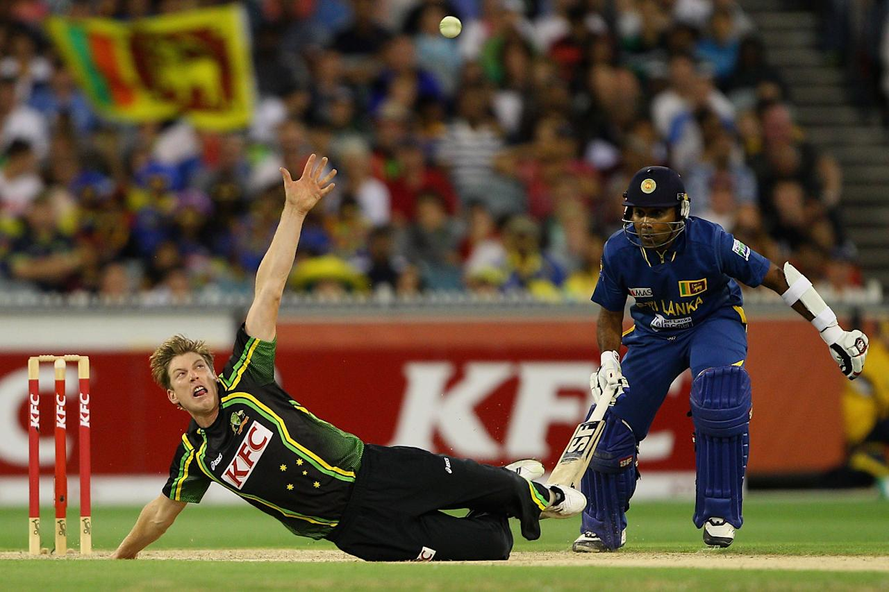 MELBOURNE, AUSTRALIA - JANUARY 28:  James Faulkner of Australia attempts to field the ball off his own bowling after falling during game two of the Twenty20 International series between Australia and Sri Lanka at Melbourne Cricket Ground on January 28, 2013 in Melbourne, Australia.  (Photo by Robert Prezioso/Getty Images)
