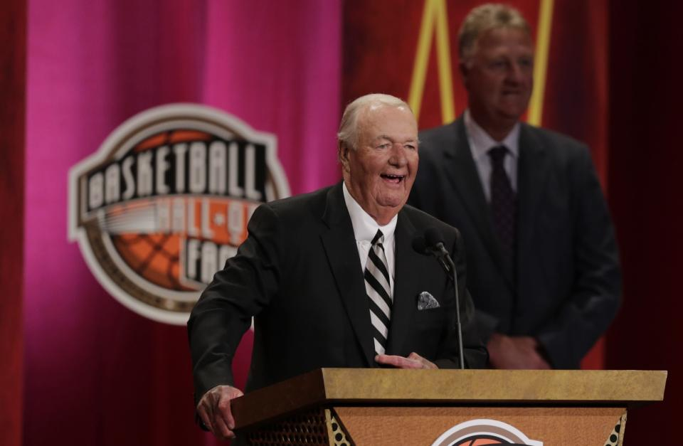 "FILE - Former basketball head coach Bob ""Slick"" Leonard smiles as he addresses a gathering during his enshrinement ceremony for the Basketball Hall of Fame in Springfield, Mass., in this Friday, Aug. 8, 2014, file photo. Leonard, the former NBA player and Hall of Fame coach who won three ABA championships with the Indiana Pacers and spent more than a half century with the organization, has died. He was 88. His death was announced by the Pacers on Tuesday, April 13, 2021. (AP Photo/Charles Krupa, File)"