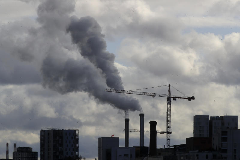Smoke billows from a plant just outside the French capital, Wednesday, Nov. 13, 2019 in Paris. The world's thirst for oil will continue to grow until the 2030s, with climate-damaging emissions climbing until at least 2040 — and consumers' insatiable appetite for SUVs is a big reason why. (AP Photo/Michel Euler)