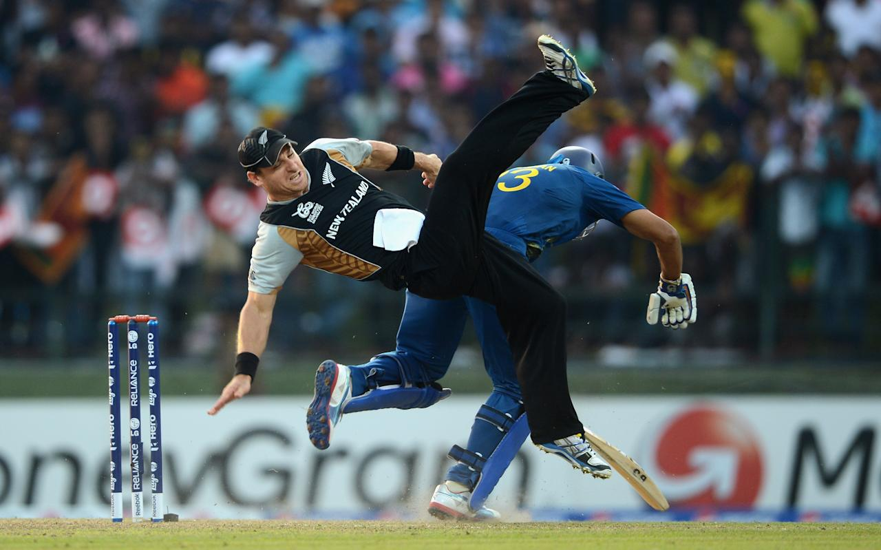 KANDY, SRI LANKA - SEPTEMBER 27:  Nathan McCullum of New Zealand collides with Tillakaratne Dilshan of Sri Lanka during the  ICC World Twenty20 2012 Super Eights Group 1 match between Sri Lanka and New Zealand at Pallekele Cricket Stadium on September 27, 2012 in Kandy, Sri Lanka.  (Photo by Gareth Copley/Getty Images)