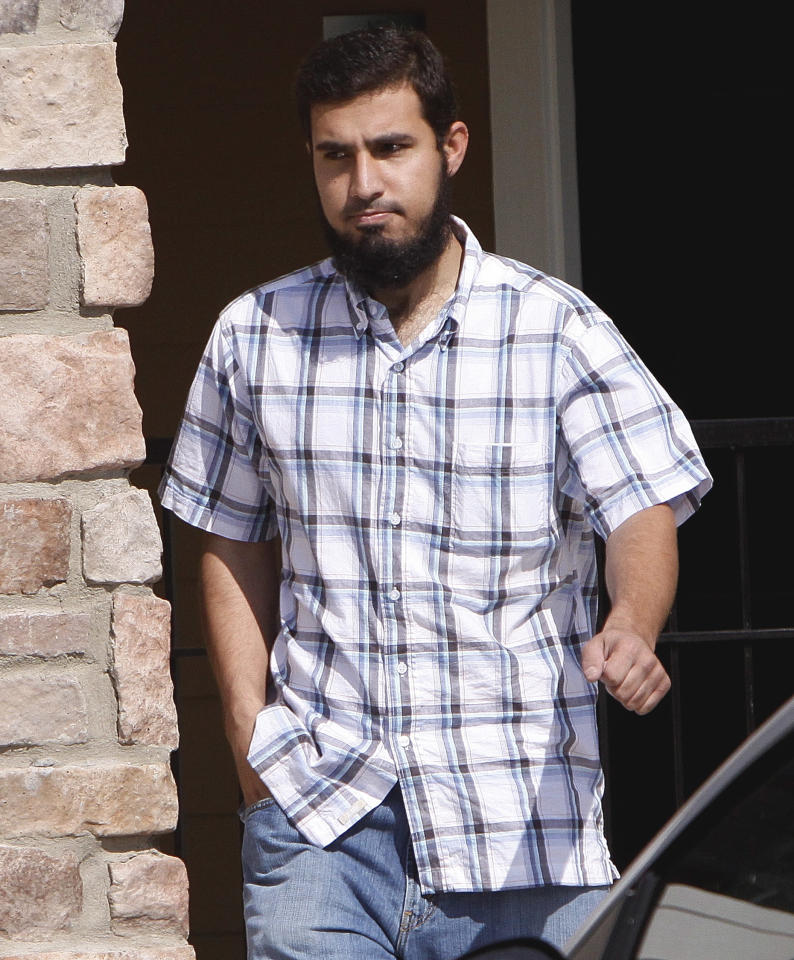 FILE - In this Sept. 17, 2009 file photo, Najibullah Zazi leaves his apartment in Aurora, Colo., for a meeting with his attorney. When New York undercover officers and informants were infiltrating a mosque in Queens in 2006, they failed to notice the increasingly radical sentiments of a young man who prayed there. Police also kept tabs on a Muslim student group at Queens College, but missed a member's growing anti-Americanism. Those two men and friends _ Zazi at the mosque and Adis Medunjanin at the school _ would go on to be accused of plotting a subway bombing that officials have called the most serious terrorist threat to the United States since Sept. 11, 2001. (AP Photo/Ed Andrieski, File)