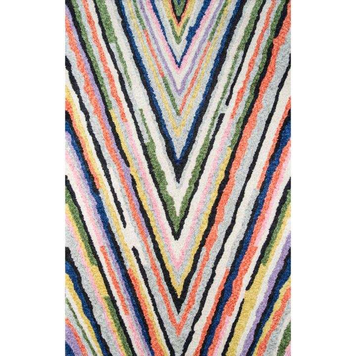The deep V pattern of this colorful striped rug gives it a geometric vibe that works well with its extra-fuzzy tufting. Novogratz by Momeni Notch Area Rug, $149; at AllModern