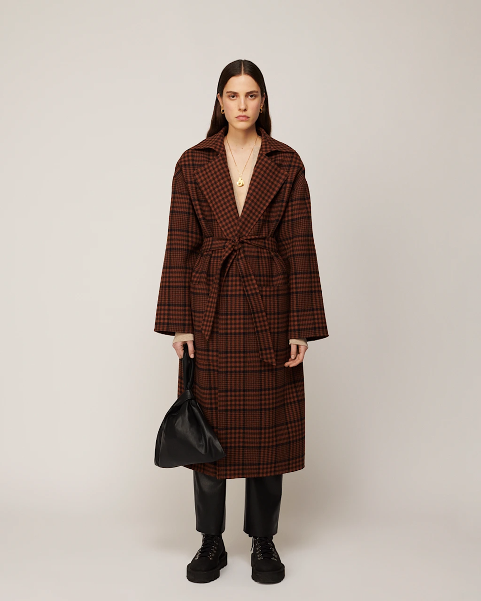 "<br><br><strong>Nanushka</strong> Alamo Oversized Robe Coat, $, available at <a href=""https://go.skimresources.com/?id=30283X879131&url=https%3A%2F%2Fwww.nanushka.com%2Fproduct%2F3259-alamo-oversized-robe-coat-check"" rel=""nofollow noopener"" target=""_blank"" data-ylk=""slk:Nanushka"" class=""link rapid-noclick-resp"">Nanushka</a>"