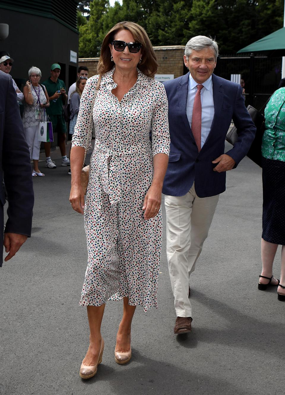 <p>Carole Middleton made her second appearance at Wimbledon 2018 on 11 July in a printed Max Mara shirt dress. Another twinning look for mother and daughter? <em>[Photo: PA] </em> </p>