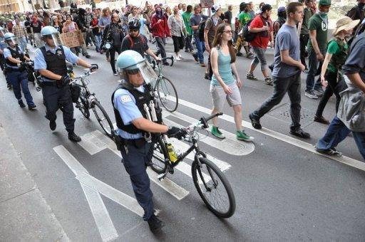Demonstrators with Occupy Chicago march through the streets in Chicago, Illinois on May 18, escorted by local police ahead of the NATO 2012 Summit. Three NATO summit activists suspected of planning to throw Molotov cocktails during protests in Chicago face terrorism charges, their lawyers said Saturday