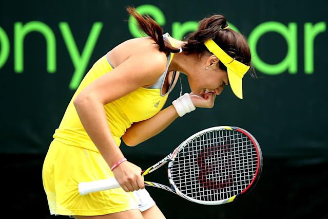 KEY BISCAYNE, FL - MARCH 22: Sorana Cirstea of Romania celebrates a point against Silvia Soler-Espinosa of Spain during the Sony Open at Crandon Park Tennis Center on March 22, 2013 in Key Biscayne, Florida. (Photo by Matthew Stockman/Getty Images)