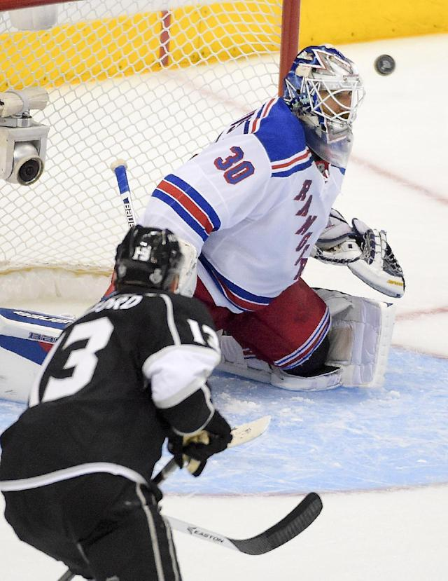 New York Rangers goalie Henrik Lundqvist, of Sweden, top, blocks a shot by Los Angeles Kings left wing Kyle Clifford during the third period in Game 1 of the NHL hockey Stanley Cup Finals, Wednesday, June 4, 2014, in Los Angeles. (AP Photo/Mark J. Terrill)