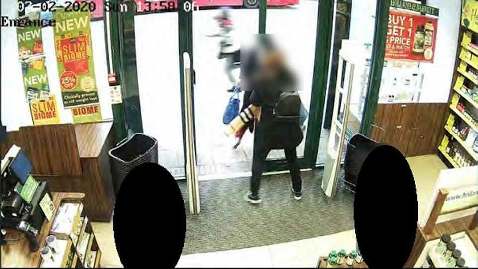 Sudesh Amman running along Streatham High Road as he stabbed passers by, captured on footage from Holland and Barrett (Metropolitan Police/PA) (PA Media)