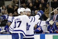 Toronto Maple Leafs' Pierre Engvall (47) celebrates with Jake Muzzin after scoring a goal during the first period of an NHL hockey game against the New York Rangers, Friday, Dec. 20, 2019, in New York. (AP Photo/Frank Franklin II)