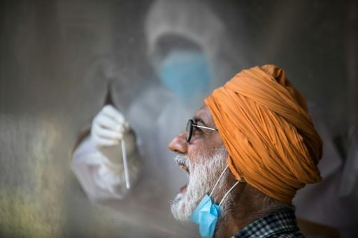 A health official conducts tests in New Delhi