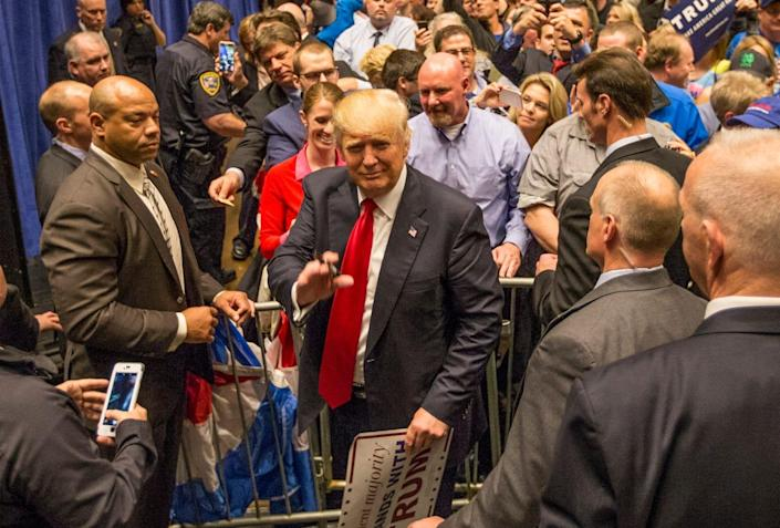 Donald Trump signs autographs following a presidential campaign rally on Monday, May 2, 2016, inside the Century Center in South Bend. Tribune Photo/ROBERT FRANKLIN