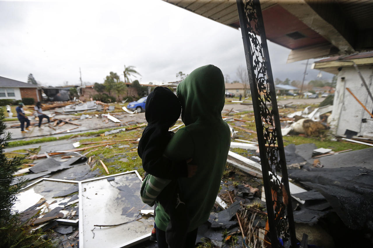 <p>Eshon Trosclair holds her son Camron Chapital after a tornado tore through their home while they were inside, Feb. 7, 2017. (Photo: Gerald Herbert/AP) </p>