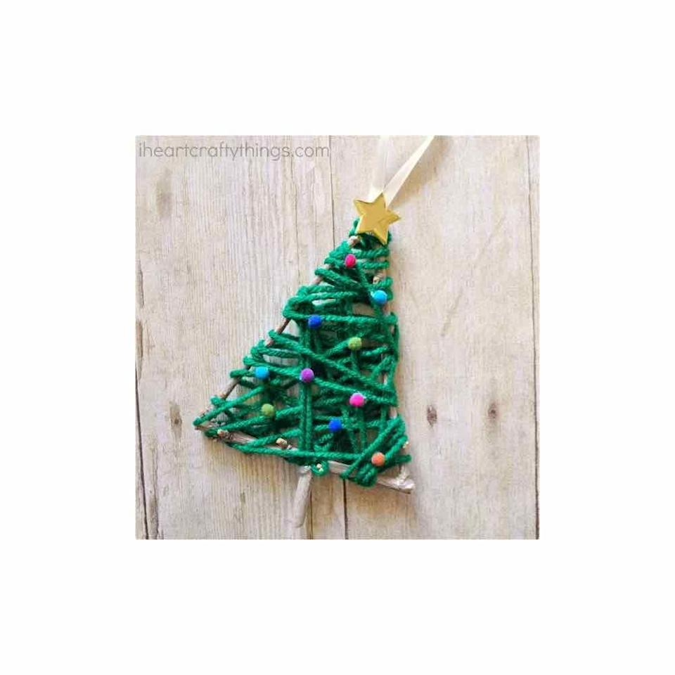 """<p>Once your kids have collected plenty of twigs, this craft comes together quickly with a ball of yarn. </p><p><em>Get the tutorial at <a href=""""https://iheartcraftythings.com/yarn-wrapped-christmas-tree-ornament.html"""" rel=""""nofollow noopener"""" target=""""_blank"""" data-ylk=""""slk:I Heart Crafty Things"""" class=""""link rapid-noclick-resp"""">I Heart Crafty Things</a>.</em></p><p><a class=""""link rapid-noclick-resp"""" href=""""https://www.amazon.com/BRAND-Company-202-130-Yarn-Stitch/dp/B07V2B4TRM?tag=syn-yahoo-20&ascsubtag=%5Bartid%7C10072.g.34443405%5Bsrc%7Cyahoo-us"""" rel=""""nofollow noopener"""" target=""""_blank"""" data-ylk=""""slk:SHOP GREEN YARN"""">SHOP GREEN YARN</a></p>"""