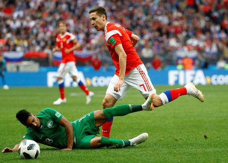 Soccer Football - World Cup - Group A - Russia vs Saudi Arabia - Luzhniki Stadium, Moscow, Russia - June 14, 2018   Russia's Daler Kuzyayev in action with Saudi Arabia's Salem Al-Dawsari                    REUTERS/Kai Pfaffenbach