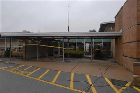 The entrance of Sandy Hook Elementary school is seen after an attack by gunman Adam Lanza in Newtown, Connecticut in this police evidence photo released by the state's attorney's office November 25, 2013. REUTERS/Connecticut Department of Justice/Handout via Reuters