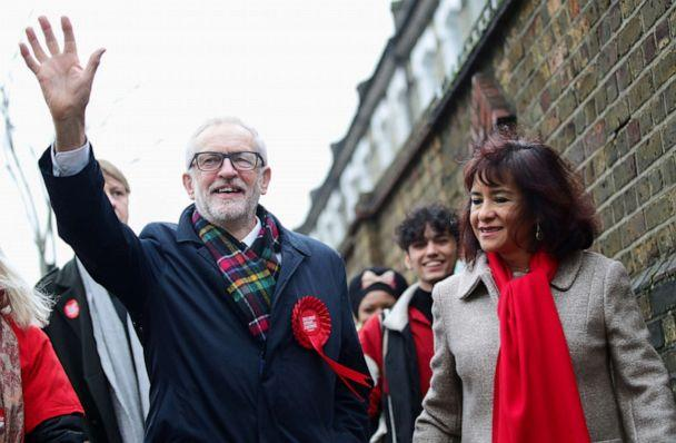 PHOTO: Britain's opposition Labour Party leader Jeremy Corbyn waves next to his wife Laura Alvarez as they walk to a polling station to vote in the general election in London, England, Dec. 12, 2019. (Lisi Niesner/Reuters)