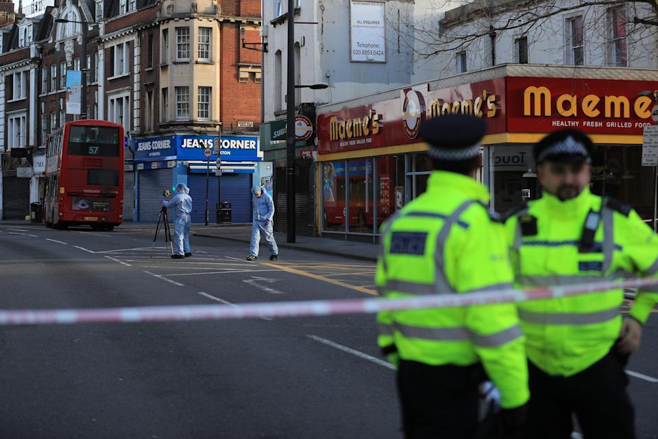 Forensic officers at the scene following the terror attack in Streatham High Road, south London, by Sudesh Amman (Aaron Chown/PA) (PA Archive)